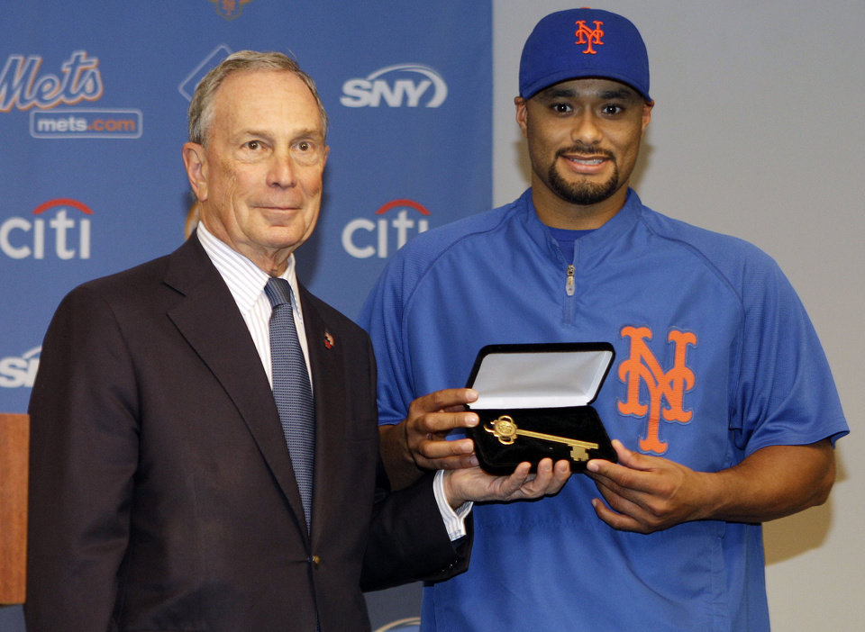 Photo -   New York City Mayor Michael Bloomberg present New York Mets starting pitcher Johan Santana with the Key to the City for his no-hitter performance against the St. Louis Cardinals before an interleague baseball game between the Mets and the New York Yankees Friday, June 22, 2012, in New York. (AP Photo/Frank Franklin II)