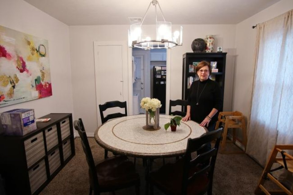 Photo -  Rhonda Hefton, a founding board member of HopeHouse OKC, stands in the dining room of the newly renovated Hannah's House for pregnant participants of ReMerge. [Doug Hoke/The Oklahoman]