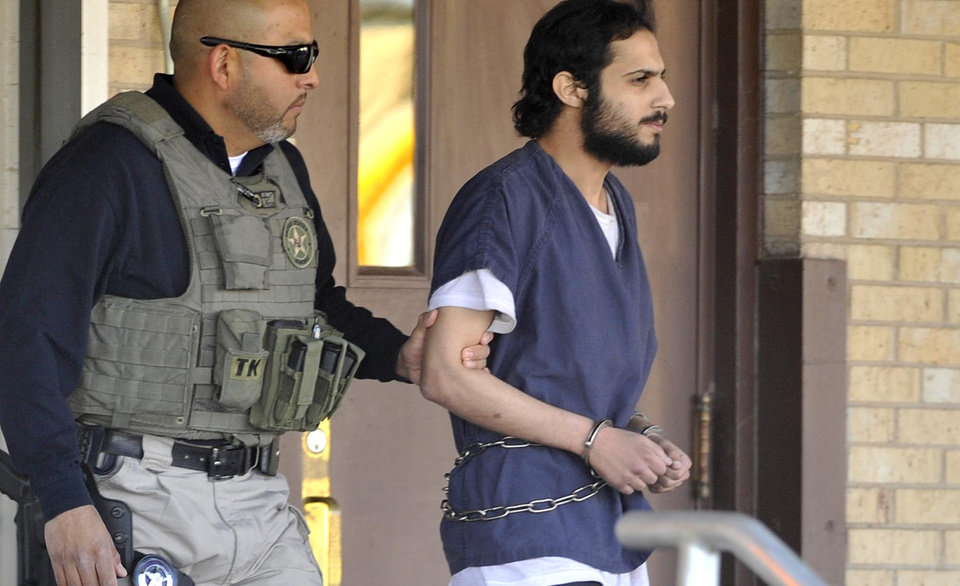 Photo -   Khalid Ali-Aldawsari, 22, right, is escorted from the federal courthouse in Amarillo, Texas by U.S. Marshals Tuesday Nov. 13, 2012 after being sentenced to life in prison on a federal charge of attempting to use a weapon of mass destruction in a Lubbock-based bomb-making plot. (AP Photo/Amarillo Globe-News, Michael Schumacher) MANDATORY CREDIT; MAGS OUT; TV OUT
