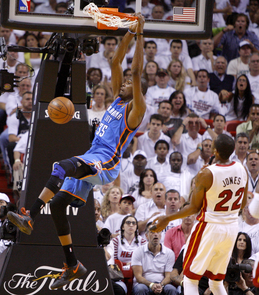 Oklahoma City\'s Kevin Durant (35) dunks the ball beside Miami\'s James Jones (22) during Game 3 of the NBA Finals between the Oklahoma City Thunder and the Miami Heat at American Airlines Arena, Sunday, June 17, 2012. Photo by Bryan Terry, The Oklahoman