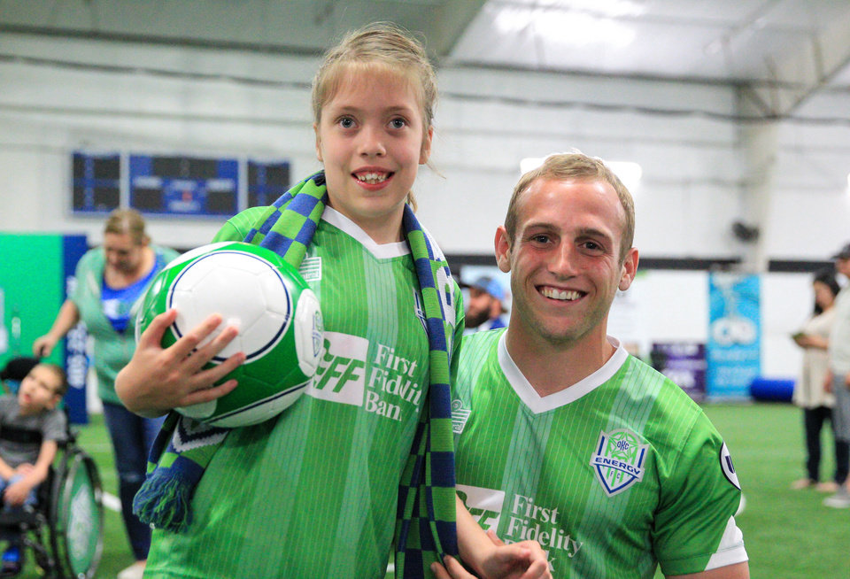 Photo - Emma Brownlow and her Energy FC Sidekicks buddy Kyle Hyland. Photo courtesy of Prodigal LLC.