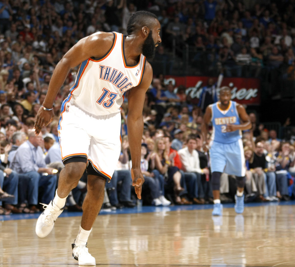 Photo - Oklahoma City's James Harden (13) celebrates a 3-point basket during the NBA basketball game between the Oklahoma City Thunder and the Denver Nuggets, Friday, April 8, 2011, at the Oklahoma City Arena.. Photo by Sarah Phipps, The Oklahoman