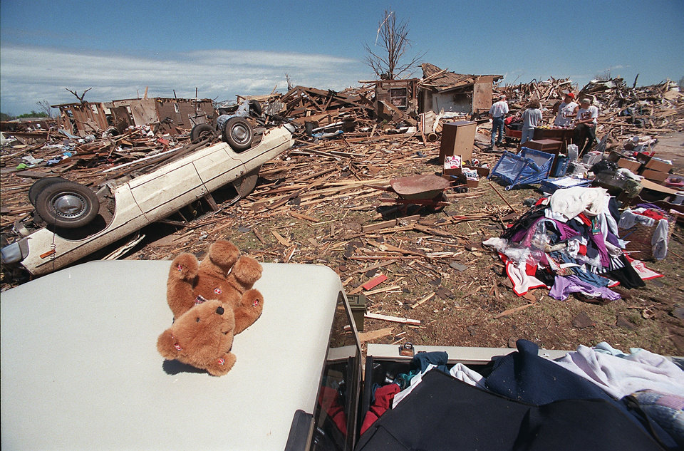 MAY 3, 1999 TORNADO: Tornado damage: A teddy bear sits on the cab of a pick-up truck loaded with possessions taken from the home of Jerry and Denise Reeves at 4749 SE 43 in Del City.  The bear was found in the ruins of the Reeves home that was destroyed in Monday's tornado.  Jerry Reeves said his son had just received the bear on April 17 as a gift on his fourth birthday.