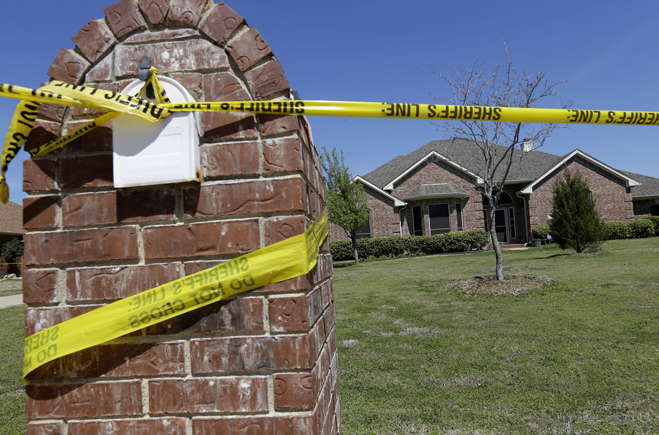 Photo - Crime scene tape is seen outside the home of Kaufman County District Attorney Mike McLelland Monday, April 1, 2013, near Forney, Texas. McLelland and his wife Cynthia were murdered at their home Saturday. (AP Photo/Tony Gutierrez)