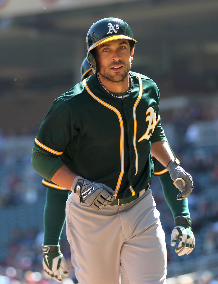 Photo - Oakland Athletics left fielder Sam Fuld runs back to the dugout after hitting a home run against the Minnesota Twins in the fourth inning of a baseball game on Thursday, April 10, 2014 in Minneapolis.(AP Photo/Andy Clayton-King)