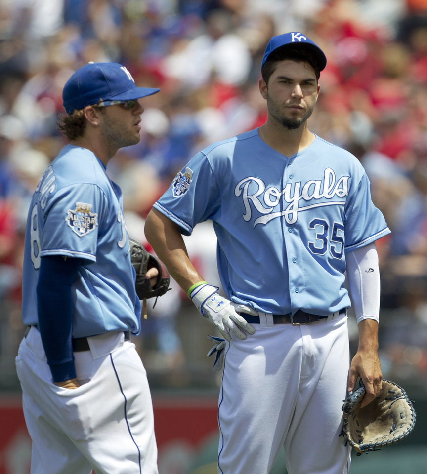 Photo -   Kansas City Royals first baseman Eric Hosmer (35) and third baseman Mike Moustakas (8) stand together during a pitching change in the fifth inning of a baseball game against the St. Louis Cardinals at Kauffman Stadium in Kansas City, Mo., Saturday, June 23, 2012. (AP Photo/Orlin Wagner)