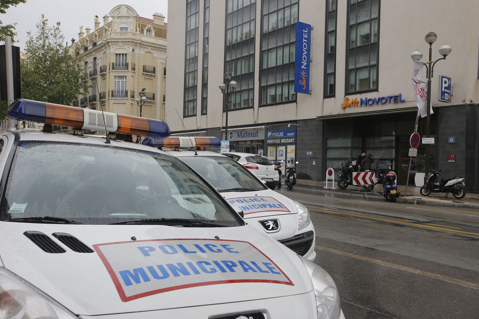Photo - Police cars park outside a hotel during the 66th international film festival, in Cannes, southern France, Friday May 17, 2013. A French police official says a thief or thieves stole about $1 million worth in jewelry inside a safe in a Novotel hotel room, against the backdrop of the Riviera resort town's film festival. (AP Photo/Lionel Cironneau)