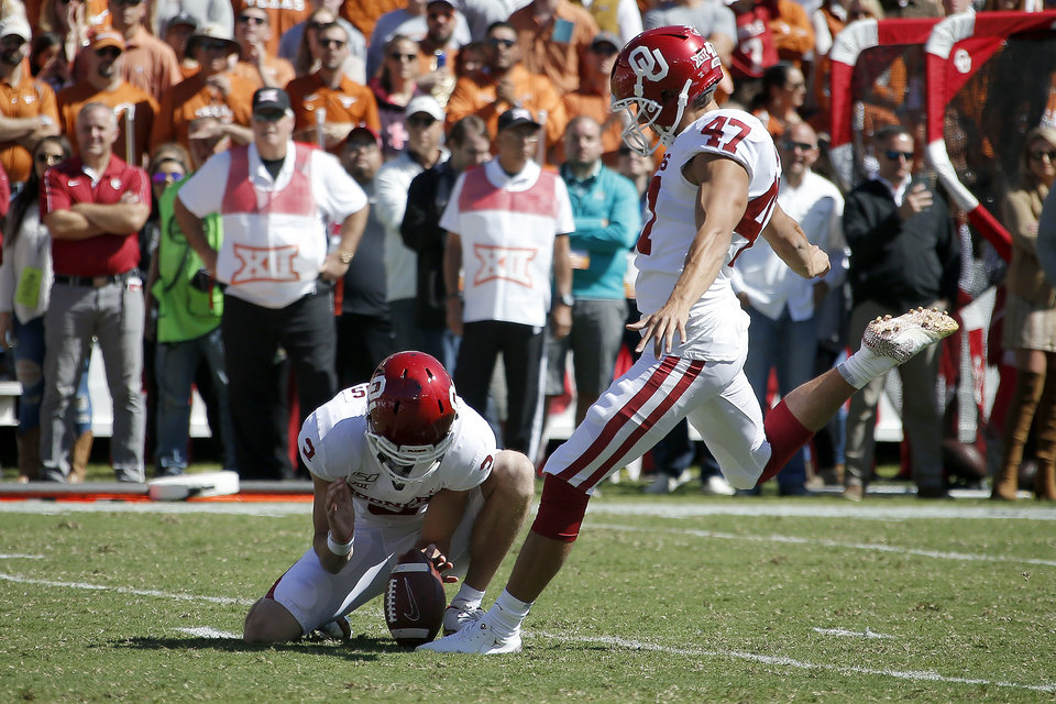Photo - Oklahoma's Gabe Brkic (47) kicks a field goal during the Red River Showdown college football game between the University of Oklahoma Sooners (OU) and the Texas Longhorns (UT) at Cotton Bowl Stadium in Dallas, Saturday, Oct. 12, 2019. Oklahoma won 34-27. [Bryan Terry/The Oklahoman]