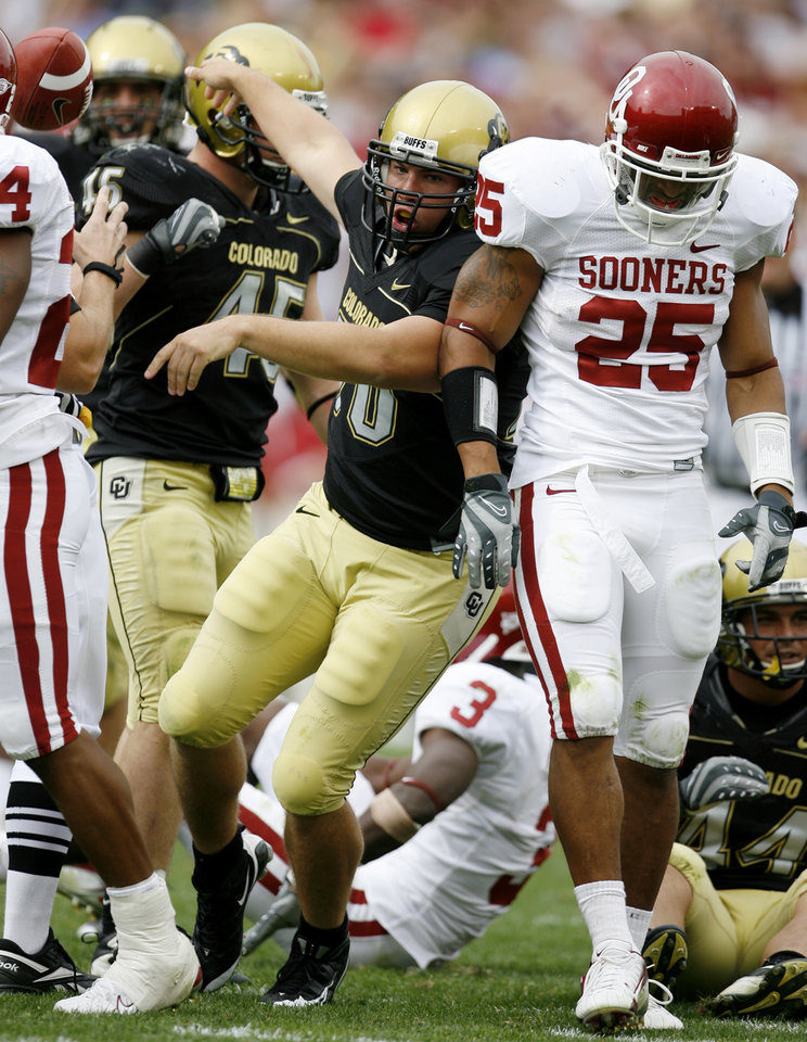 Photo - Justin Drescher of Colorado celebrates beside D.J. Wolfe  after Drescher recovered a fumble by Reggie Smith during the second half of the college football game between the University of Oklahoma Sooners (OU) and the University of Colorado Buffaloes (CU) at Folsom Field on Saturday, Sept. 28, 2007, in Boulder, Co.  By Bryan Terry, The Oklahoman