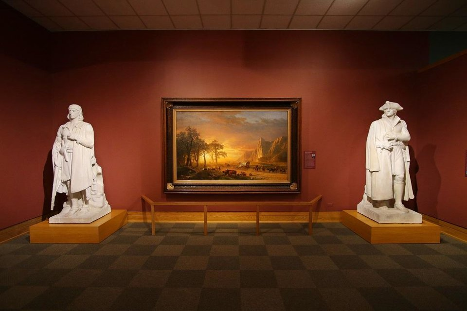 Photo -  The National Cowboy & Western Heritage Museum's remodeled Atherton Gallery is seen September 12, 2020. Heroic plaster sculptures of Lewis and Clark by James Earle Fraser now flank one of the museum's signature paintings, Albert Bierstadt's