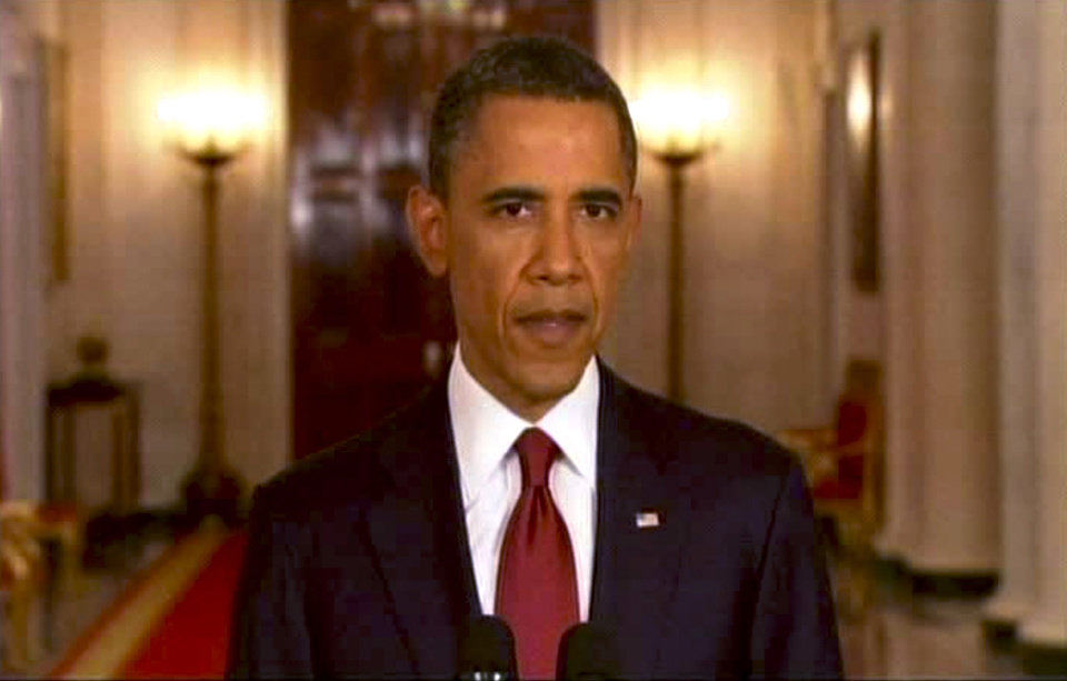 Photo - In this frame grab image taken from AP Television, President Barack Obama addresses the nation Sunday, May 1, 2011, in Washington. Osama bin Laden, the mastermind behind the Sept. 11 attacks against the United States, is dead, and the U.S. is in possession of his body, Obama announced. (AP Photo/APTN) ORG XMIT: NY217