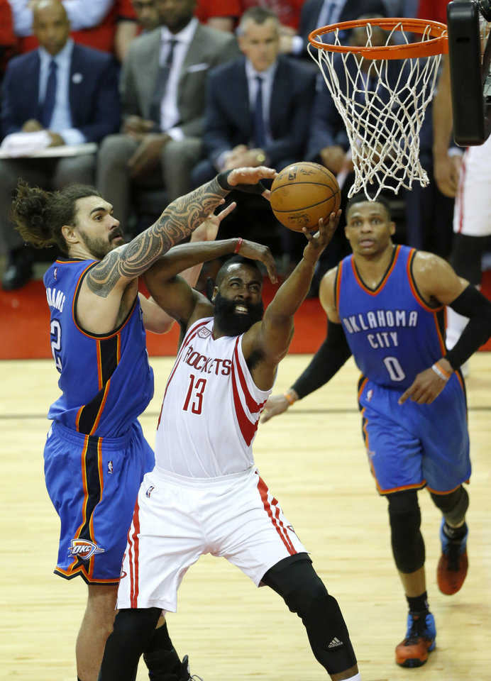 Photo - Oklahoma City's Steven Adams (12) defends over Houston's James Harden (13) during Game 5 in the first round of the NBA playoffs between the Oklahoma City Thunder and the Houston Rockets in Houston, Texas,  Tuesday, April 25, 2017.  Houston won 105-99. Photo by Sarah Phipps, The Oklahoman