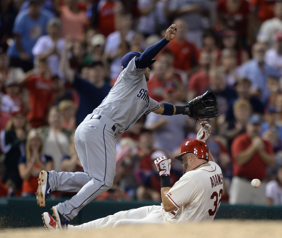Photo - St. Louis Cardinals' Matt Adams (32) slides into third with an RBI triple as San Diego Padres' Yangervis Solarte can't reach the ball in the fifth inning in a baseball game, Saturday, Aug, 16, 2014, at Busch Stadium in St. Louis. (AP Photo/Bill Boyce)