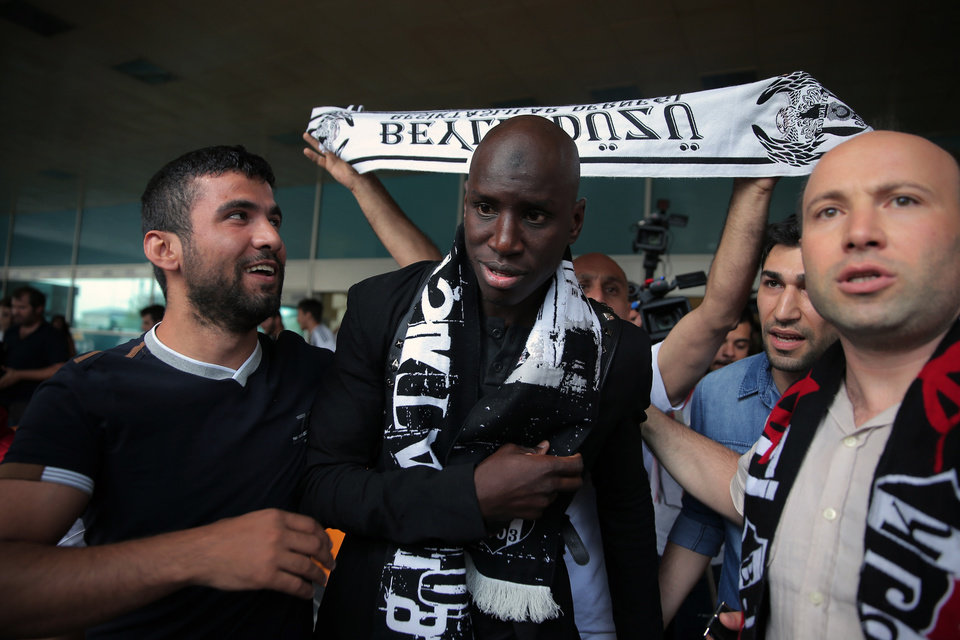 Photo - Soccer fans of Besiktas greet Demba Ba, a former Chelsea player from Senegal, at Ataturk Airport in Istanbul, Turkey, Wednesday, July 16, 2014. Ba will sign a three-year contract with Besiktas soccer club.(AP Photo/Emrah Gurel)