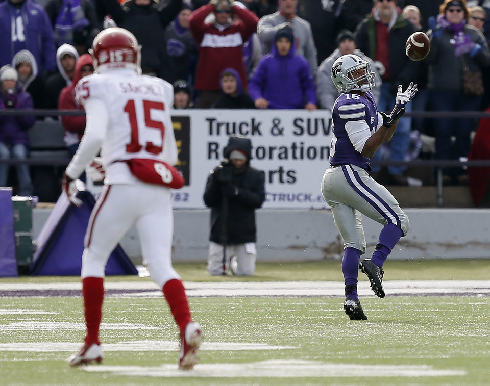 Kansas State's Tyler Lockett (16) catches a touchdown pass as Oklahoma's Zack Sanchez (15) watches during an NCAA college football game between the Oklahoma Sooners and the Kansas State University Wildcats at Bill Snyder Family Stadium in Manhattan, Kan., Saturday, Nov. 23, 2013. Oklahoma won 41-31. Photo by Bryan Terry, The Oklahoman