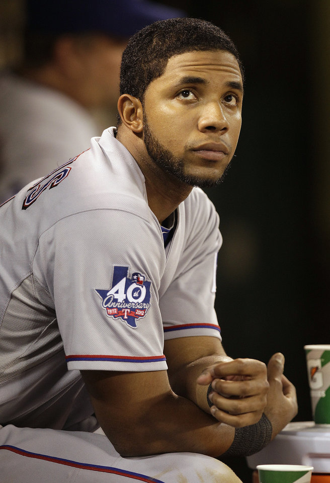 Texas Rangers' Elvis Andrus looks out from the dugout in the ninth inning of a baseball game against the Oakland Athletics Tuesday, Oct. 2, 2012, in Oakland, Calif. The Athletics won 3-1. (AP Photo/Ben Margot)