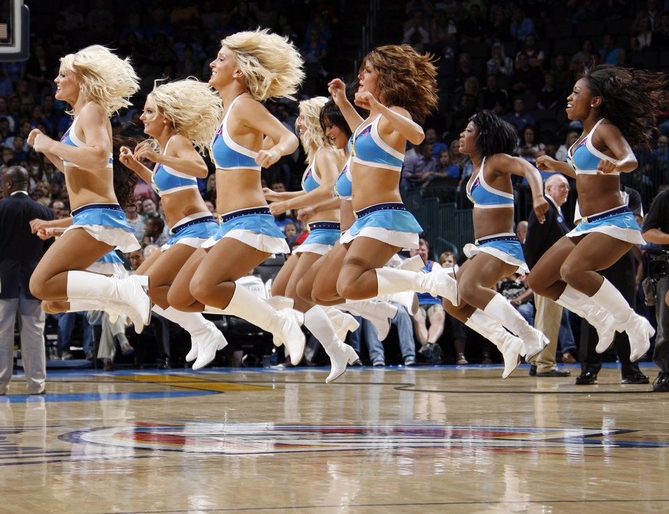Photo - The Thunder Girls perform during the preseason NBA basketball game between the New Orleans Hornets and the Oklahoma City Thunder at the Ford Center in Oklahoma City, Thursday, October 21, 2010. The Thunder won, 101-86. Photo by Nate Billings, The Oklahoman