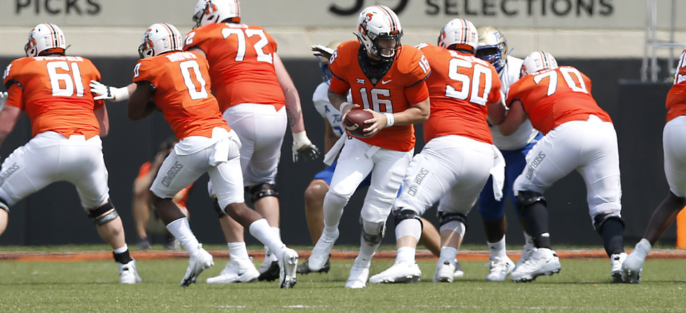 Photo -  The Oklahoma State offensive line battled injuries and position changes last Saturday against Tulsa. [JOHN CLANTON/TULSA WORLD]