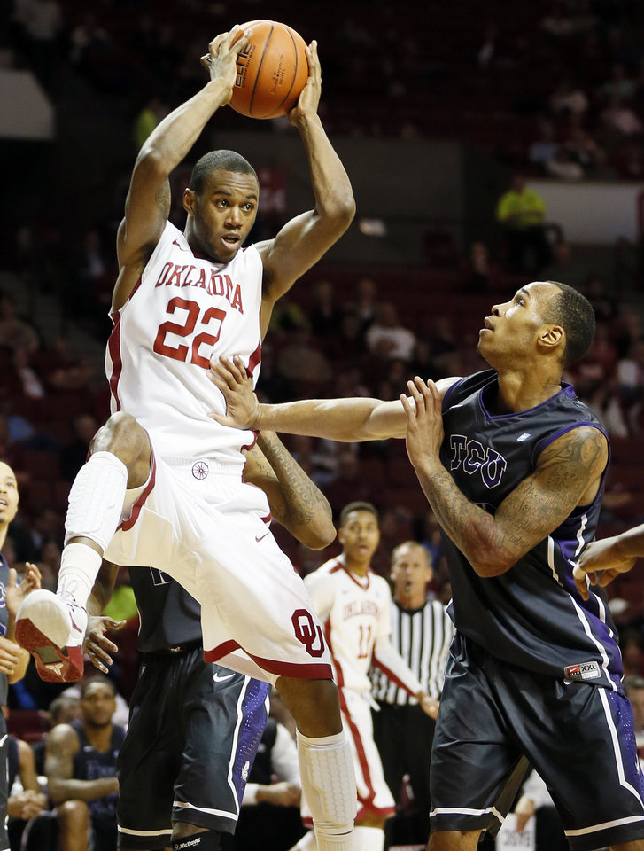 Oklahoma's Amath M'Baye (22) catches a pass next to TCU's Garlon Green (33) during an NCAA men's basketball game between the University of Oklahoma (OU) and Texas Christian University (TCU) at the Lloyd Noble Center in Norman, Okla., Monday, Feb. 11, 2013. Photo by Nate Billings, The Oklahoman