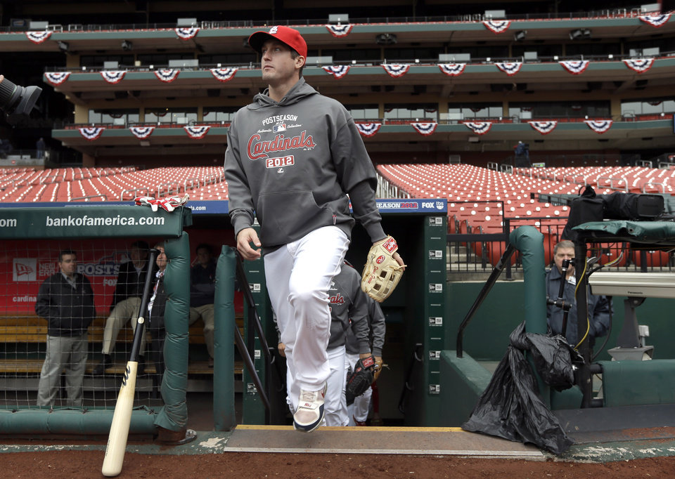 St. Louis Cardinals third baseman David Freese walks out of the Cardinals\' dugout at the start of baseball practice Saturday, Oct. 6, 2012, in St. Louis. The Cardinals and Washington Nationals are scheduled to play Game 1 in the National League division series on Sunday. (AP Photo/Jeff Roberson)