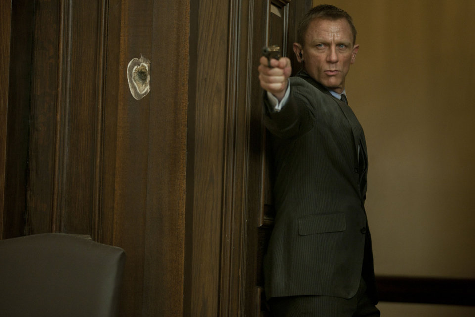"Daniel Craig as James Bond, taking aim with his trusty Walther PPK in the action thriller ""Skyfall."" SONY PICTURES PHOTO <strong></strong>"