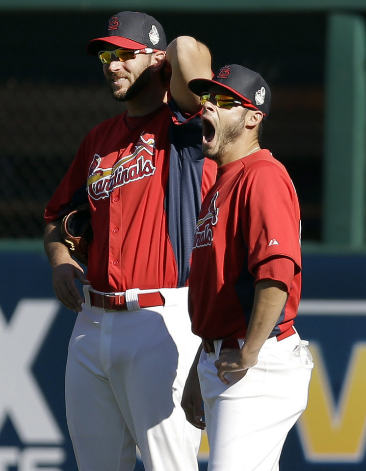Photo - St. Louis Cardinals pitcher Joe Kelly, right, yawns while standing next to fellow pitcher Adam Wainwright during baseball practice Sunday, Oct. 20, 2013, in St. Louis. The Cardinals are preparing to play the Boston Red Sox in Game 1 of the World Series on Wednesday in Boston. (AP Photo/Jeff Roberson)