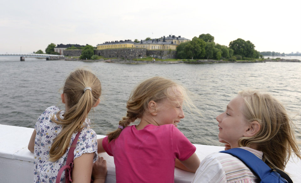 In this June 26, 2013 photo, young girls observe the Suomenlinna Fortress from the ferry that runs between Market Square and the Fortress in Helsinki, Finland. The Suomenlinna Fortress is a star-shaped bastion built in the 1700s. (AP Photo/Lehtikuva, Martti Kainulainen)  FINLAND OUT