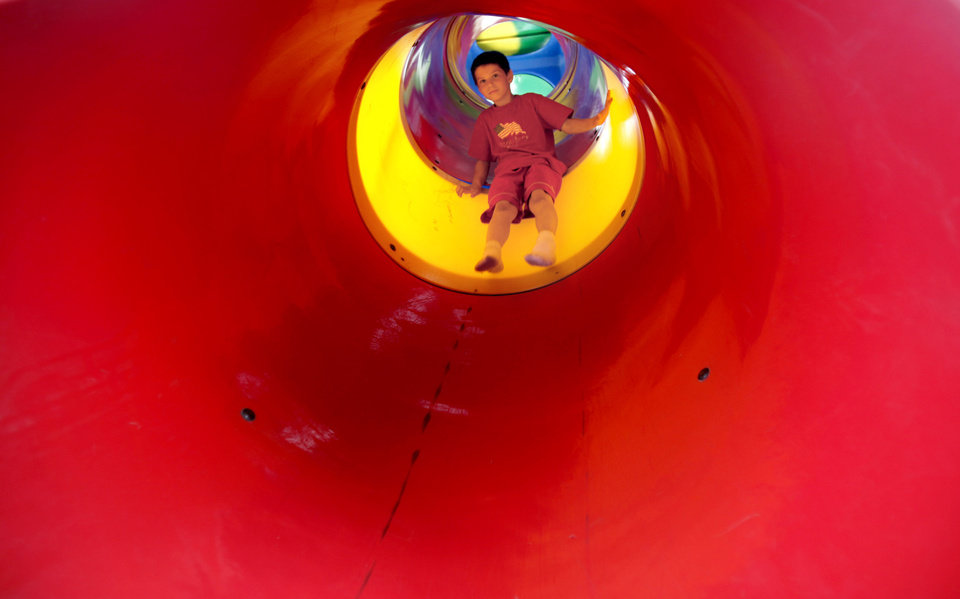 Colline Weber, 7, of Warr Acres, Okla., plays on a slide during Bethany's Centennial Freedom Festival, Saturday,  July 4, 2009, at Eldon Lyon Park in Bethany, Okla. Photo by Sarah Phipps, The Oklahoman