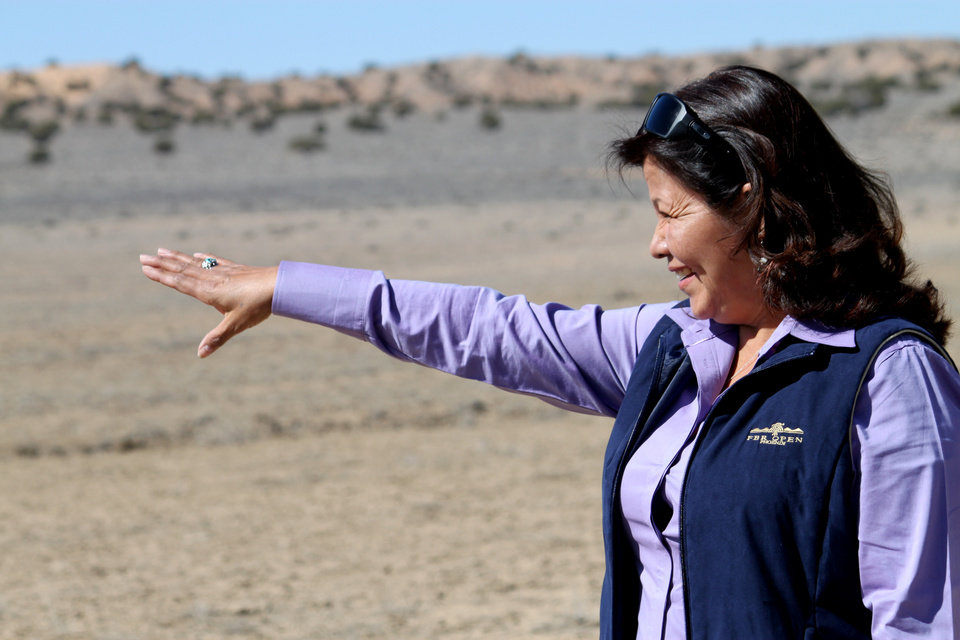 In this March 13, 2012 photo, Delores Apache, president of To'Hajiilee Economic Development Inc., points to where solar panels will be installed near the Navajo community of To'Hajiilee, N.M. The community has received funding from the U.S. Department of Energy's Tribal Energy Program for a planned 30-megawatt solar photovoltaic plant. Once constructed, the plant stands to be the largest photovoltaic array on tribal land. (AP Photo/Susan Montoya Bryan)