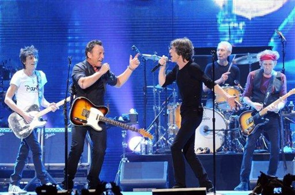 Photo - Musician Bruce Springsteen, center left, performs with, from left, Ronnie Wood, Mick Jagger, Charlie Watts and Keith Richards of The Rolling Stones at the Prudential Center in Newark, NJ on Saturday, Dec. 15, 2012. (Photo by Evan Agostini/Invision/AP)