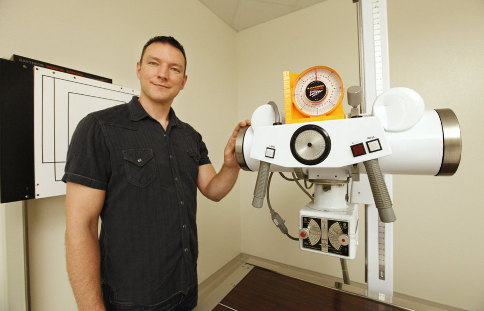 Kyle Compton, Okla. City, with an X-ray machine in a lab inside the Health Sciences building at Rose State College in Midwest City Friday, July 26, 2013. Kyle recently graduated from Rose State with a radiologic technologist degree. Photo by Paul B. Southerland, The Oklahoman