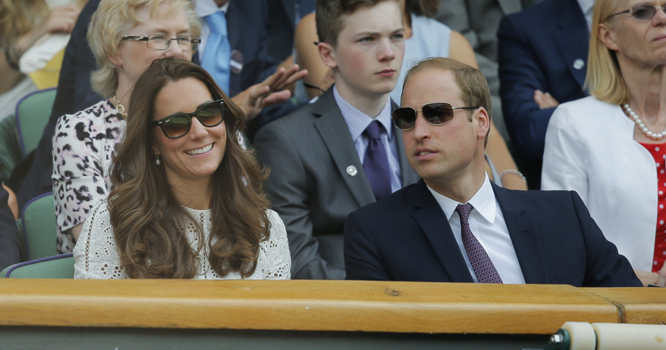 Photo - Britain's Prince William, right, and Kate, Duchess of Cambridge watch from the Royal Box on centre court during the men's singles quarterfinal match between Andy Murray of Britain and Grigor Dimitrov of Bulgaria at the All England Lawn Tennis Championships in Wimbledon, London, Wednesday, July 2, 2014. (AP Photo/Pavel Golovkin)