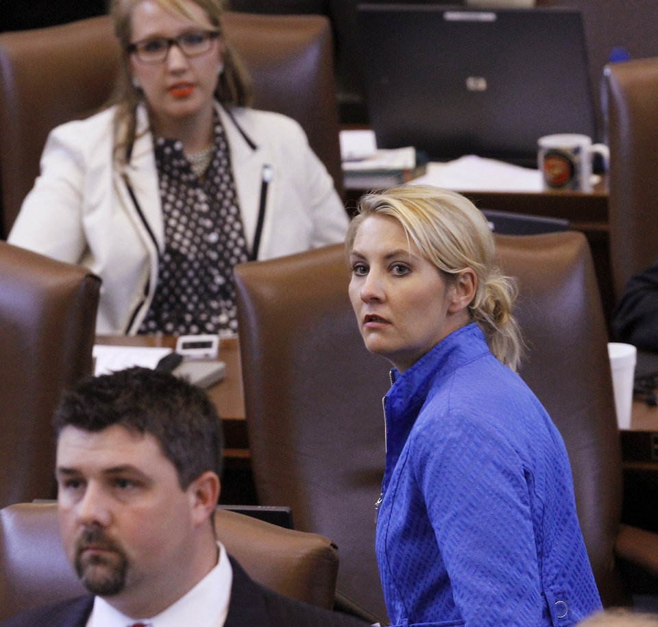 Rep. Skye McNiel (cq), the majority whip in the House, stands to watch the vote tally during a vote in the Oklahoma House of Representatives on Thursday afternoon, May 24, 2012, where members voted 52-42 to pass a $6.8 million  general appropriation bill to finance a state  budget  that begins in July. The House had failed to garner enough votes to pass the bill earlier in the day.   Photo by Jim Beckel, The Oklahoman