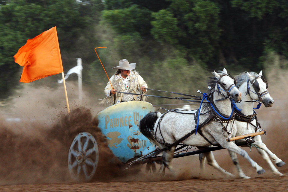 Photo - Kevin Webb steers a team of horses as he participates in a chariot race during  the Pawnee Bill Wild West Show in Pawnee, Oklahoma on Saturday,  June 23, 2012.  Photo by Jim Beckel, The Oklahoman