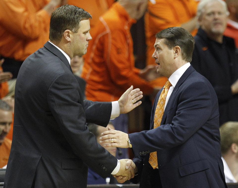 Photo -   Portland State head coach Tyler Geving, left, and Oklahoma State head coach Travis Ford, right, shake hands following their NCAA college basketball game in Stillwater, Okla., Sunday, Nov. 25, 2012. Oklahoma State won 81-58. (AP Photo/Sue Ogrocki)