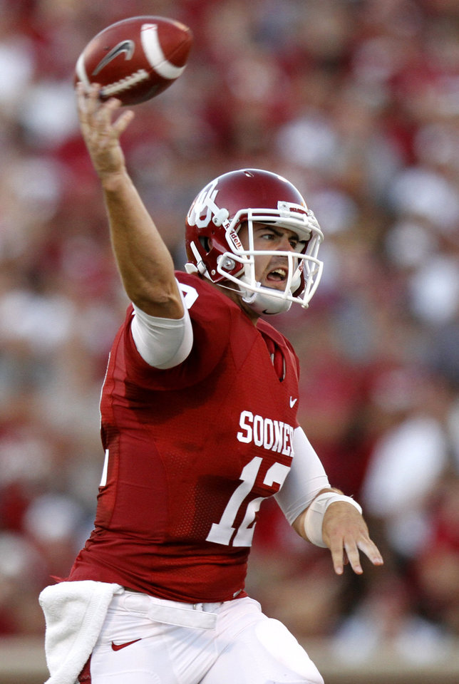 Photo - Oklahoma's Landry Jones (12) throws a pass during the college football game between the University of Oklahoma Sooners (OU) and the Ball State Cardinals at Gaylord Family-Memorial Stadium on Saturday, Oct. 01, 2011, in Norman, Okla. Photo by Bryan Terry, The Oklahoman