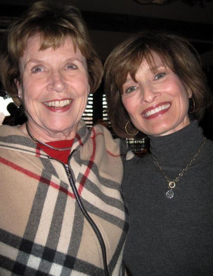 CELEBRATING...Jane Harlow and Kirk Hammons were at the party in the  home of Judy Love. Love and Barbara Brou had a holiday open house.  (Photo by Helen Ford Wallace).