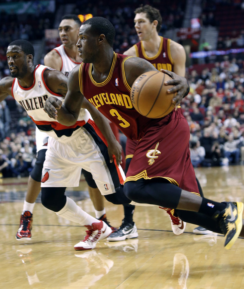 Cleveland Cavaliers guard Dion Waiters, right, drives to the basket past Portland Trail Blazers guard Wesley Matthews during the first quarter of an NBA basketball game in Portland, Ore., Wednesday, Jan. 16, 2013.(AP Photo/Don Ryan)