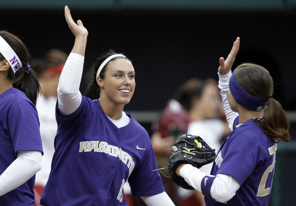 Washington starting pitcher Danielle Lawrie greets teammates after ending the second inning against Oklahoma in an NCAA super regional softball game Friday, May 28, 2010, in Seattle. Washington won 3-0 to force a deciding third game later in the evening. (AP Photo/Elaine Thompson) ORG XMIT: WAET109