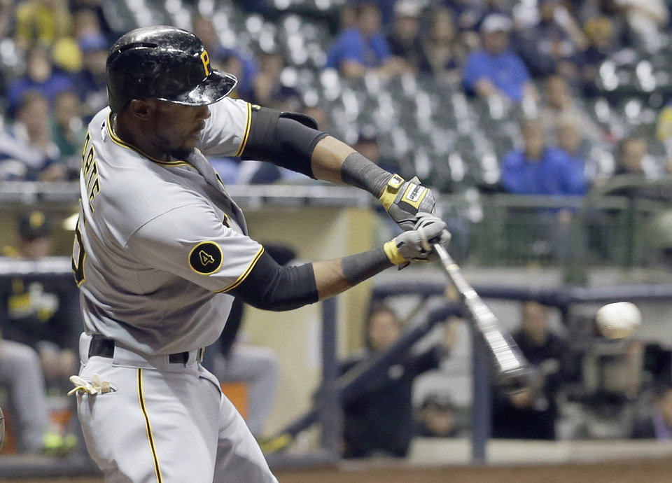 Photo - Pittsburgh Pirates' Starling Marte hits a two-run scoring double during the ninth inning of a baseball game against the Milwaukee Brewers Wednesday, May 14, 2014, in Milwaukee. (AP Photo/Morry Gash)