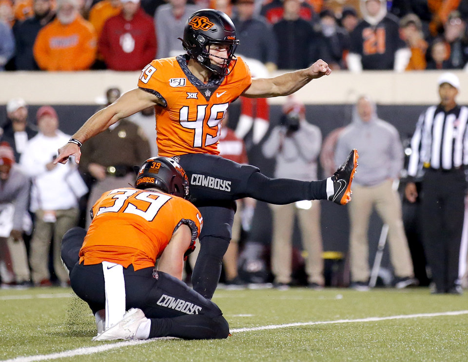 Photo - Oklahoma State's Matt Ammendola (49) kicks a field goal as Jake McClure (39) holds in the second quarter during the Bedlam college football game between the Oklahoma State Cowboys (OSU) and Oklahoma Sooners (OU) at Boone Pickens Stadium in Stillwater, Okla., Saturday, Nov. 30, 2019. OU won  34-16. [Sarah Phipps/The Oklahoman]