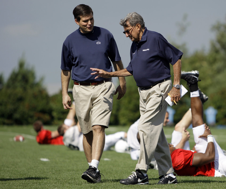 Photo -   FILE - In this Aug. 8, 2008, file photo, Penn State football coach Joe Paterno, right, walks with his son and quarterback coach Jay Paterno as players stretch out during NCAA college football practice in State College, Pa. A new era is dawning at Penn State, with a new football coach and a new look to the uniforms. But no Paterno on the sideline in a season opener for the first time since 1965. Penn State plays Ohio on Saturday. (AP Photo/Carolyn Kaster, File)