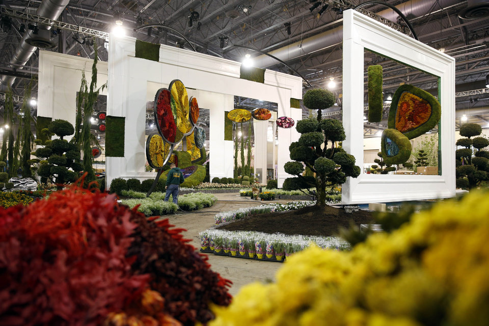 """Photo - Work is conducted on the entrance garden in preparation for the annual Philadelphia Flower Show at the Pennsylvania Convention Center, Thursday, Feb. 27, 2014, in Philadelphia. The garden is inspired by the paintings and sculptures of Alexander """"Sandy"""" Calder. The nation's largest flower show will feature huge horticultural displays inspired by the work of artists such as Matisse, Mondrian, Calder and Kandinsky."""