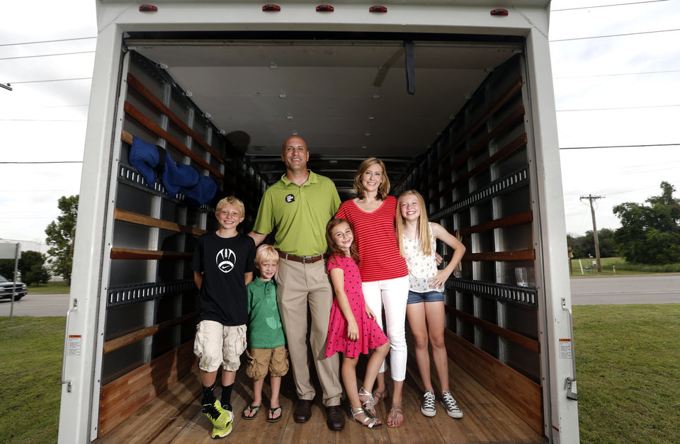 Photo - Chance Wilson, Holt Wilson, Andrew Wilson, Izzy Wilson, Krista Wilson and Ellie Wilson pose in the company's moving van. The family is expanding its Tulsa moving business to Oklahoma City. Photo by Sarah Phipps, The Oklahoman  SARAH PHIPPS - SARAH PHIPPS