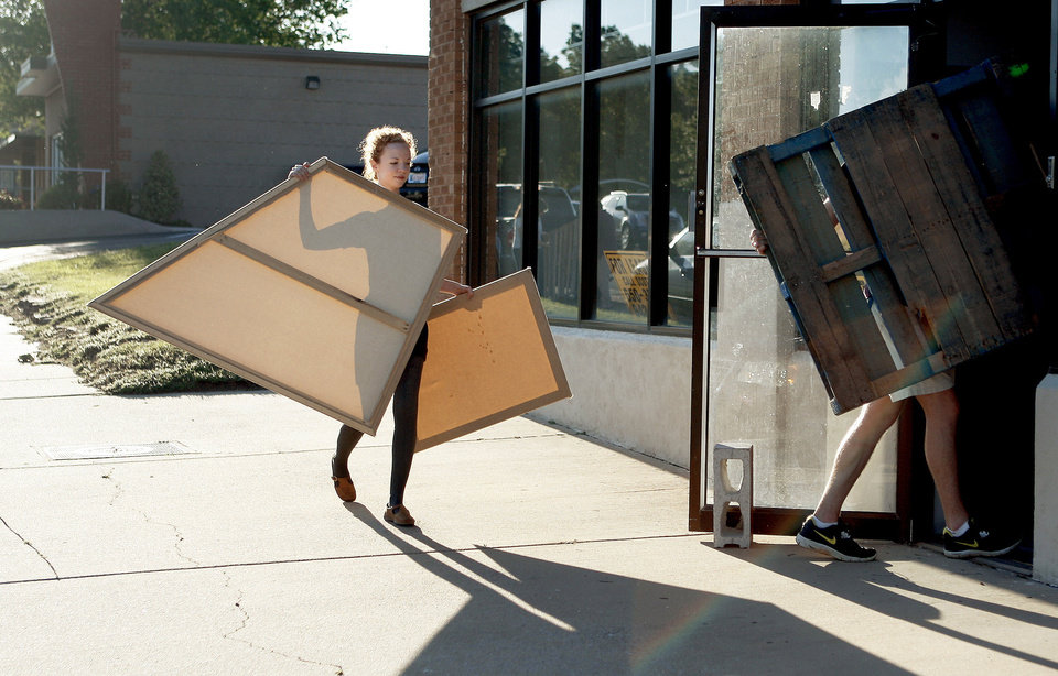 """Photo - Madeleine Wiens carries supplies for the upcoming """"Better Block OKC"""" event."""
