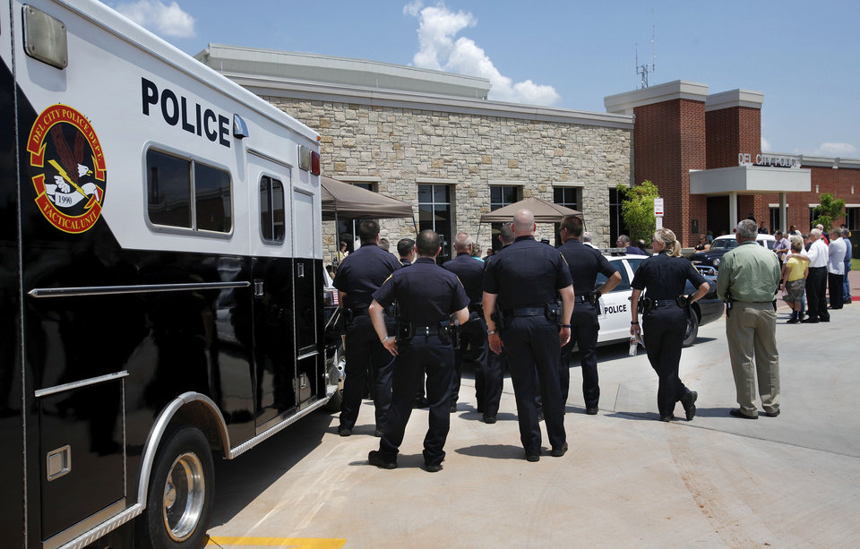 Photo - Officers stand by during the dedication of the new police station in Del City Thursday afternoon.  Jim Beckel - THE OKLAHOMAN