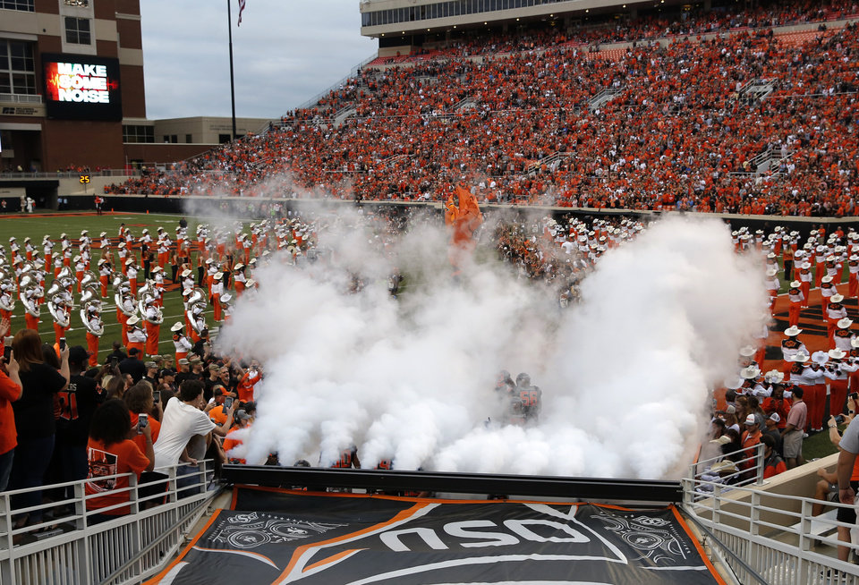 Photo - Oklahoma State runs on to the field before a college football game between Oklahoma State (OSU) and South Alabama at Boone Pickens Stadium in Stillwater, Okla., Saturday, Sept. 8, 2018. Photo by Sarah Phipps, The Oklahoman