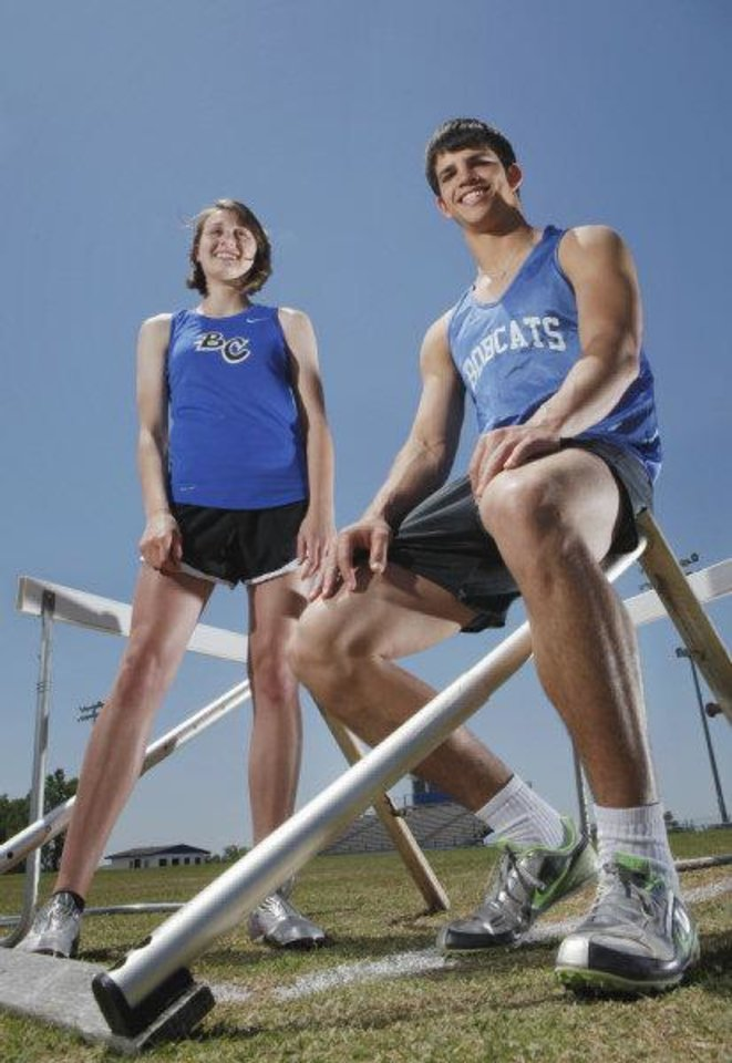 Photo - Bridge Creek track athletes Caden Locke and Abby Mayfield at the high school football/track practice field on Thursday, May 5, 2011, in Bridge Creek, Okla.  Photo by Steve Sisney, The Oklahoman  STEVE SISNEY - THE OKLAHOMAN