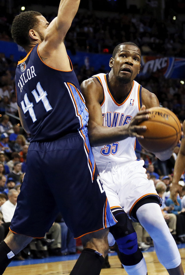 Oklahoma City's Kevin Durant (35) works against Charlotte's Jeffery Taylor (44) during an NBA basketball game between the Oklahoma City Thunder and Charlotte Bobcats at Chesapeake Energy Arena in Oklahoma City, Monday, Nov. 26, 2012.  Photo by Nate Billings , The Oklahoman