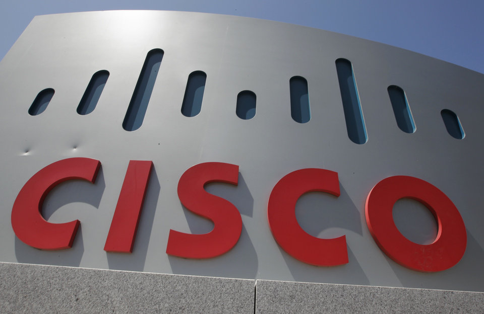 This Wednesday, May 9. 2012, file photo, shows an exterior view of Cisco headquarters in Santa Clara, Calif. Cisco Systems Inc., the world\'s largest maker of computer networking gear, said Sunday, Nov. 18, 2012, it is buying Meraki for $1.2 billion to expand its ability to let customers compute in the cloud, (AP Photo/Paul Sakuma)